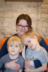 Present Place Chicago Owner Alicia Hyberger posing with her two sons